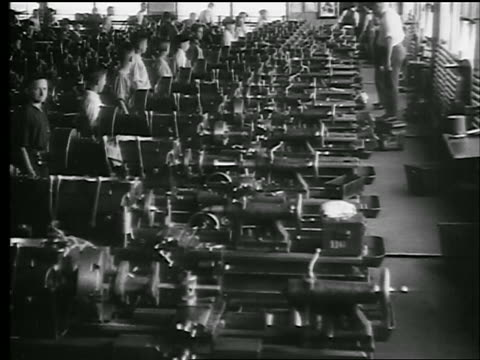 b/w 1920s high angle boys working at machines in factory / they line up + exercise / doc. - 1920 stock videos & royalty-free footage