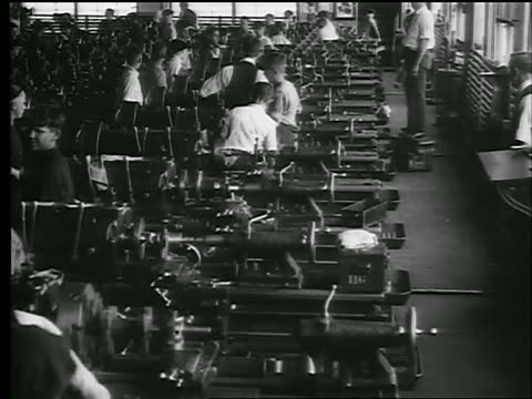 B/W 1920s high angle boys working at machines in factory / they line up + exercise / doc.