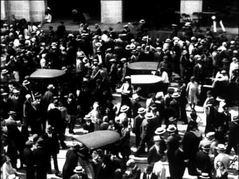 b/w 1920s high angle crowd walking on boardwalk / atlantic city / newsreel - 1920 video stock e b–roll