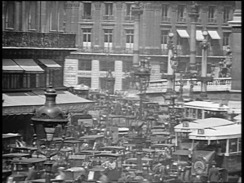 B/W 1920s high angle time lapse traffic on city street / Paris / documentary