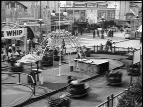 "b/w 1920s high angle ""whip"" ride at coney island / nyc / newsreel - coney island brooklyn stock videos & royalty-free footage"