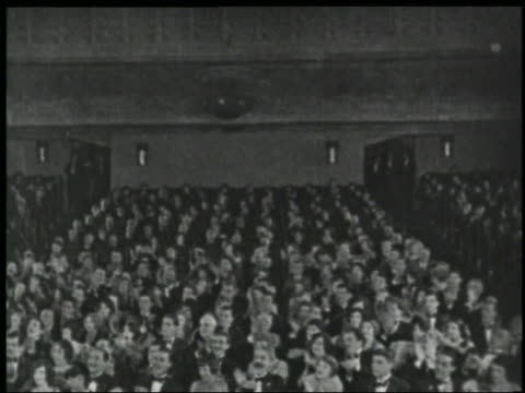 b/w 1920s high angle wide shot audience clapping in theater - audience stock videos and b-roll footage