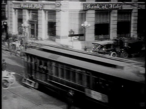 1920s high speed busy intersection of 7th and broadway / los angeles, california, united states - 1920 stock-videos und b-roll-filmmaterial