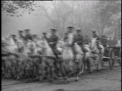 1920s horses trotting along road with soldiers riding, pulling caissons for the parade of the unknown soldier / washington d.c., united states - recreational horseback riding stock videos & royalty-free footage