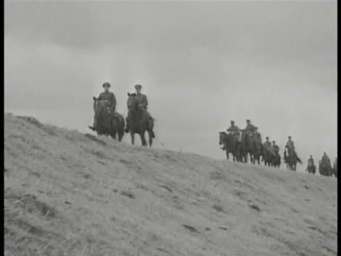 JAPANESE EMPEROR TU MS Young Emperor Hirohito on DARK horse holding something folded possibly map WS Soldiers on horseback walking hilltop road MS...