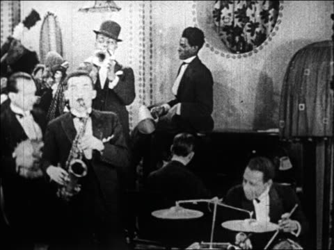 B/W 1920s jazz band playing in nightclub / Paris, France / documentary