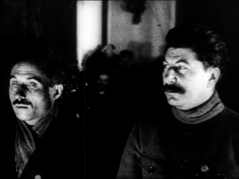 b/w 1920s joseph stalin other man looking offscreen / russia / documentary - ex unione sovietica video stock e b–roll
