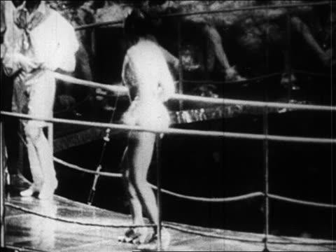 B/W 1920s Josephine Baker dancing wildly in performance at Folies Bergere / Paris / newsreel