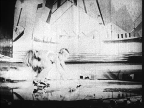b/w 1920s josephine baker doing charleston in costume / folies bergere / paris france / documentary - ventenne video stock e b–roll