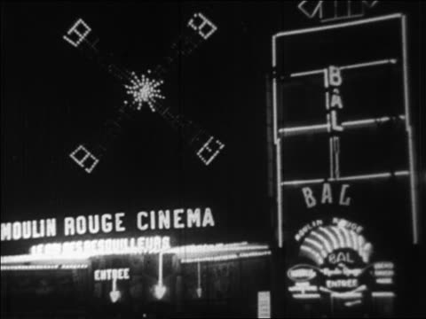 b/w 1920s lights + sign on moulin rouge cinema at night / paris, france / newsreel - 1920 stock videos & royalty-free footage