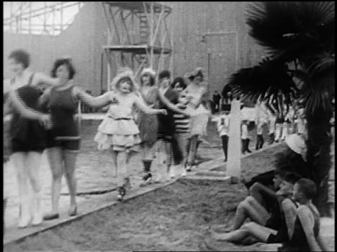 b/w 1920s line of women in swimsuits (1890s to 1920s) walking beside swimming pool outdoors - beauty contest stock videos & royalty-free footage