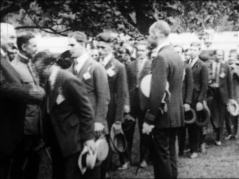 1920s line of ww i veterans standing in line waiting to shake hands with warren harding / newsreel - 60 64 years stock videos & royalty-free footage