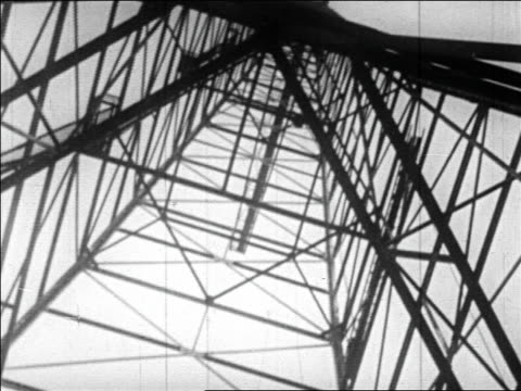b/w 1920s low angle close up radio antenna tower - communications tower stock videos & royalty-free footage