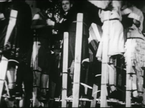 b/w 1920s low angle couples dancing on stilts in nyc nightclub / newsreel - stilts stock videos and b-roll footage