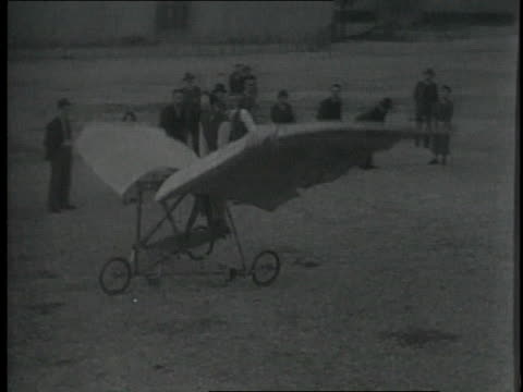 1920s WS Man pedaling experimental plane with flapping wings