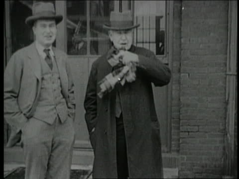 B/W 1920s man standing with Thomas Edison