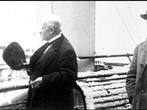 medicine ms french psychologist pharmacist emile coue dressed in coat bowler hat standing on snowy ship's deck cu nodding speaking coue method... - hypnosis stock videos and b-roll footage