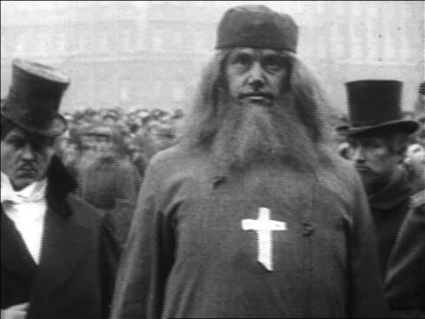 1920s men in costumes mocking czars + religion / russia / documentary - 軍事パレード点の映像素材/bロール