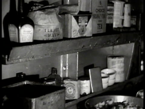 merchant marine cook working in front of stove in galley pantry shelf in galley whole chickens in pot on stove crewman washing hands in basin sink cu... - galeere stock-videos und b-roll-filmmaterial