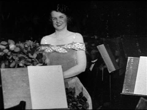 metropolitan opera ms soprano marian tally walking behind orchestra holding roses smiling bowing soprano grace moore 'tennessee nightingale' sitting... - upper west side manhattan stock videos and b-roll footage