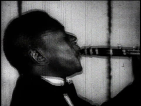 1920s montage black musicians playing / united states - brass instrument stock videos & royalty-free footage