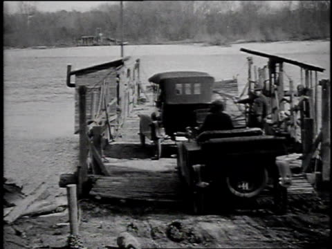 1920s montage car driving on a ferry boat to cross river then driving off onto land / united states - ferry stock videos & royalty-free footage