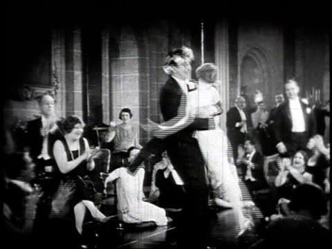 stockvideo's en b-roll-footage met 1920s montage couple dancing at party, woman faints / united states - 1920