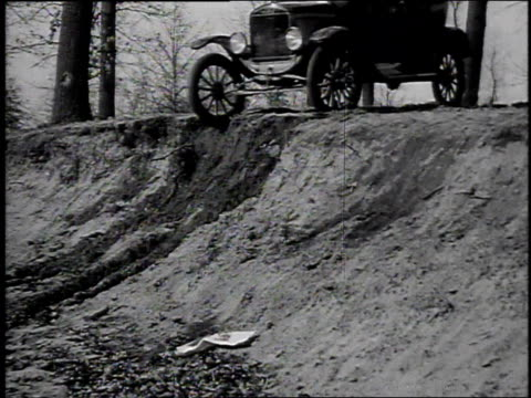 1920s montage model t car driving down dirt embankment / united states - ford motor company stock videos and b-roll footage