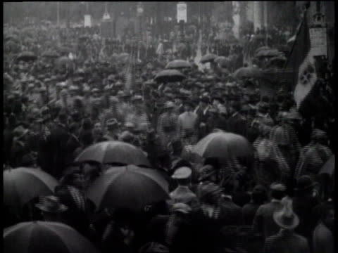 1920s MONTAGE people protesting and Fascists marching in the street / Italy