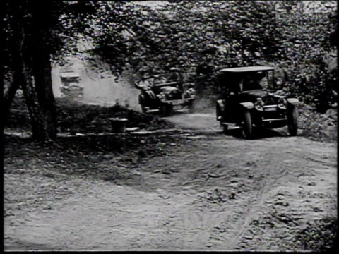 1920s montage president warren g harding arrives by car to a campsite in the great smokey mountains / north carolina united states - フォード・t型モデル点の映像素材/bロール