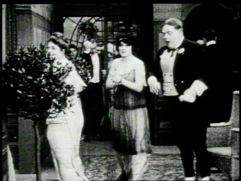1920s montage women dancing with a men at a party  - 人の年齢点の映像素材/bロール