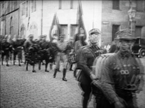 b/w 1920s nazi brown shirts in uniform carrying flags marching in street / germany / docu - nazi germany stock videos and b-roll footage