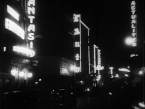 b/w 1920s neon lights on city street at night / paris, france / newsreel - 1920 video stock e b–roll