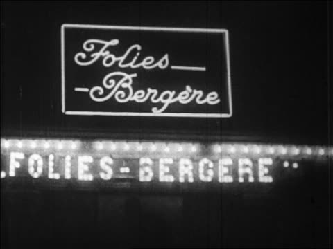 b/w 1920s neon sign + lights on folies bergere at night / paris, france / newsreel - 1920 stock videos & royalty-free footage