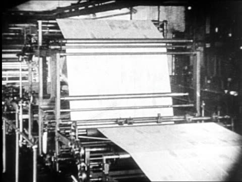 b/w 1920s newspapers rolling on printing press / newsreel - printing press stock videos & royalty-free footage