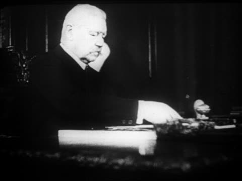b/w 1920s paul von hindenburg sitting at desk in office / docu - weimar video stock e b–roll