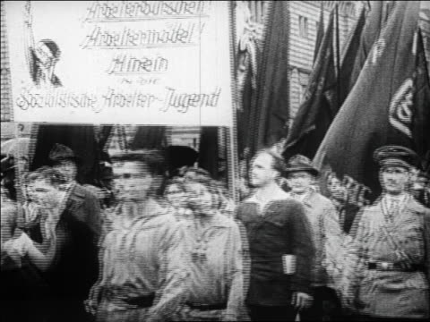 1920s people carrying signs + flags marching in parade at political rally / germany / docu. - 30 39 years stock videos & royalty-free footage