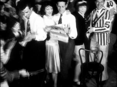 b/w 1920s people dancing + reading during dance marathon - paar mittleren alters stock-videos und b-roll-filmmaterial