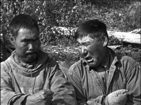 b/w 1920s portrait 2 inuit men making funny face at camera / travelogue - play fight stock videos and b-roll footage