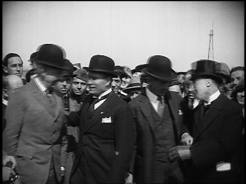 b/w 1920s portrait benito mussolini explorer roald amundsen in bowlers posing with other men - benito mussolini stock videos & royalty-free footage