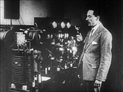 b/w 1920s profile man talking into microphone near radio controls - microphone stock videos & royalty-free footage