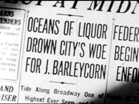prohibition cu newspaper article title 'oceans of liquor drown city's woe' ms handpainted sign over window 'barleycorn gone but not forgotten' ms... - 1920 stock videos & royalty-free footage