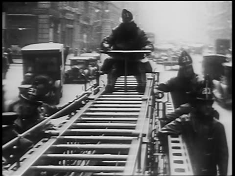 b/w 1920s rear fire truck point of view of firefighters riding on back of speeding truck on city street - yorkville illinois stock videos & royalty-free footage