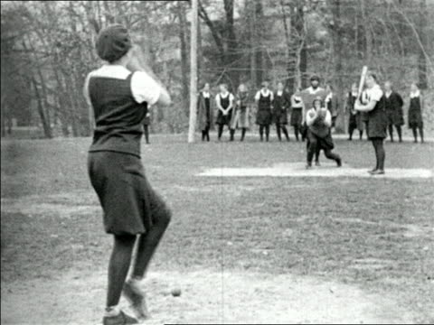 B/W 1920s REAR VIEW girl pitching to girl at bat in baseball game outdoors / short subject
