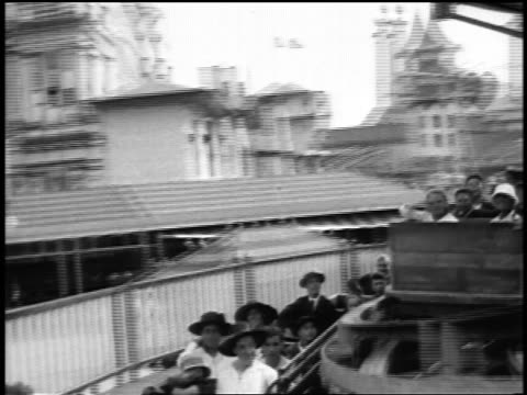 """b/w 1920s ride point of view people sitting in """"top"""" rotating ride at coney island / nyc / newsreel - coney island stock videos & royalty-free footage"""