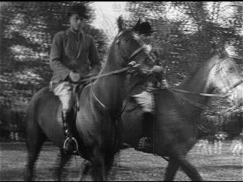 edward, prince of wales, on horseback wearing riding clothes w/ another male in traditional hunting clothing 'colours', possibly master of foxhounds,... - prince stock videos & royalty-free footage