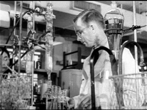 SCIENCE VS Two male scientists working behind hanging tubes beakers HA WS Iconic small Northern or Midwest American town VS Two children playing in...