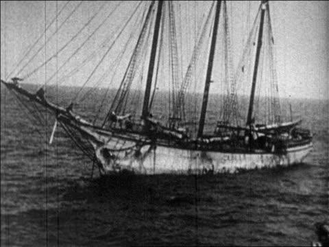 B/W 1920s ship on ocean smuggling bootleg liquor / Prohibition / newsreel