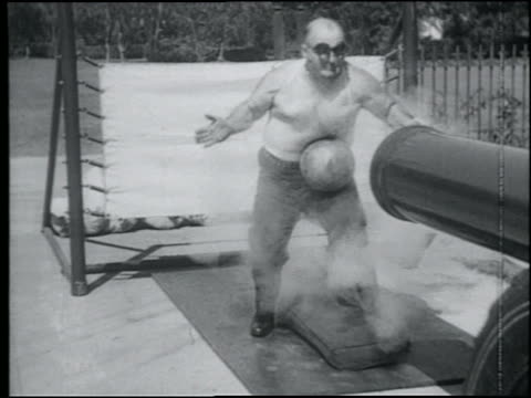 B/W 1920s slow motion bare-chested man (FA/JR? Richards) getting hit by cannon ball in stomach for stunt