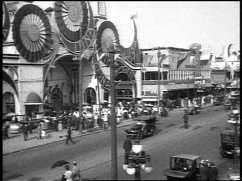 b/w 1920s slow motion cars driving in front of luna park entrance at coney island / newsreel - coney island brooklyn stock videos & royalty-free footage